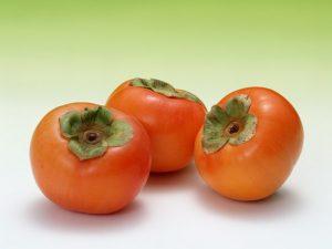 柿の実3個緑バック